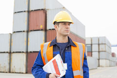 Mid adult man with clipboard in shipping yard Stock Photography