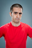 Mid Adult Man with Confused Expression Royalty Free Stock Images