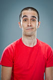 Mid Adult Man with Confused Expression Royalty Free Stock Image