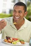 Mid Adult Man Dining Al Fresco Stock Images
