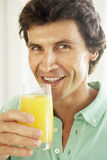 Mid Adult Man Drinking A Glass Of Orange Juice Stock Images