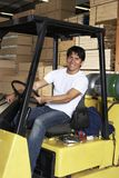 Mid Adult Man Driving Forklift Loader In Warehouse Stock Photos