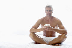 Mid Adult Man Eating A Bowl Of Cereal Stock Photos