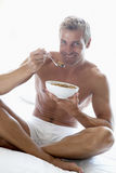 Mid Adult Man Eating A Bowl Of Cereal Stock Photography
