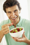 Mid Adult Man Eating Fresh Fruit Stock Photos