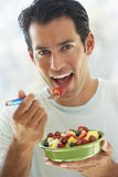 Mid Adult Man Eating Fresh Fruit Salad Royalty Free Stock Photos