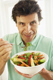 Mid Adult Man Eating A Healthy Salad Stock Images