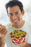 Mid Adult Man Eating Salad Royalty Free Stock Photos
