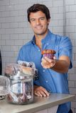 Mid Adult Man Holding Cupcake At Supermarket Stock Photos