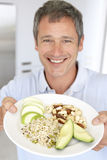 Mid Adult Man Holding Plate Of Healthy Food Royalty Free Stock Photography