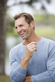 Mid adult man laughing standing in garden Stock Images