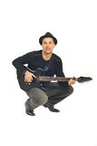 Mid adult man playing guitar Stock Photo