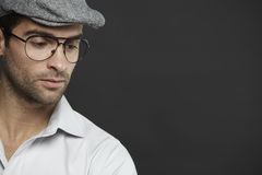 Mid adult man wearing glasses and hat Stock Image