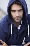 Mid adult man wearing hooded top Stock Photography
