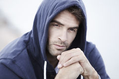 Mid adult man wearing hooded top Royalty Free Stock Photo