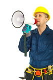 Mid adult man worker shout megaphone. Mid adult worker man shouting through megaphone over white background Stock Photography