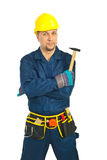 Mid adult repairman with hammer Stock Photo