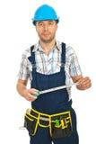 Mid adult repairman holding ruler Stock Photos