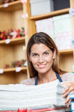 Mid Adult Saleswoman With Papers In Shop Stock Images