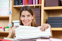 Mid Adult Saleswoman With Papers In Store Royalty Free Stock Images