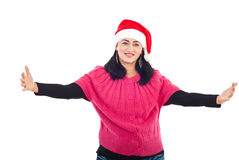 Mid adult Santa helper woman with open hands. Beautiful Santa helper mid adult woman standing with open arms preparing for hugging isolated on white background Stock Image