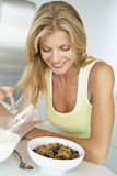 Mid Adult Woman Eating Healthy Breakfast Royalty Free Stock Photos