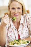 Mid Adult Woman Eating A Healthy Meal Royalty Free Stock Photography