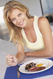 Mid Adult Woman Eating Unhealthy Breakfast Royalty Free Stock Images