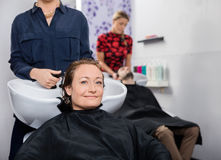 Mid Adult Woman Getting Hair Washed In Salon Stock Images