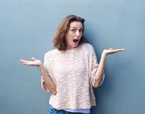 Mid adult woman with hands raised in confusion Royalty Free Stock Photos