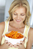 Mid Adult Woman Holding A Bowl Of Carrots Stock Image
