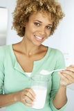Mid Adult Woman Holding Dietary Supplements Royalty Free Stock Image