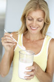 Mid Adult Woman Holding Dietary Supplements Royalty Free Stock Photo