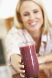 Mid Adult Woman Holding A Fresh Berry Smoothie Stock Photos