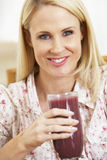 Mid Adult Woman Holding A Fresh Berry Smoothie Royalty Free Stock Photos