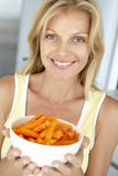 Mid Adult Woman Holding A Plate Of Carrots Royalty Free Stock Image