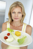 Mid Adult Woman Holding A Plate Of Healthy Food Royalty Free Stock Photography