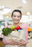 Mid Adult Woman Holding Shopping Bag with Fruits and Vegetables Stock Photos