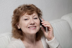 Mid adult woman at home Stock Photos