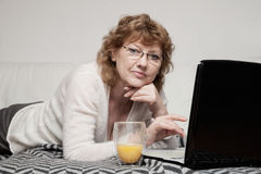 Mid adult Woman with laptop stock photo