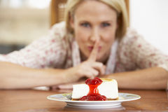 Mid Adult Woman Looking At Cheesecake Stock Photo