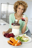 Mid Adult Woman Making Fresh Vegetable Juice Royalty Free Stock Images