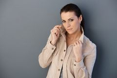 Mid-adult woman posing in spring jacket royalty free stock photo