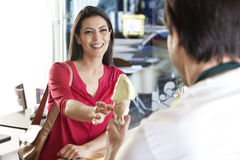 Mid Adult Woman Receiving Ice Cream From Waiter Stock Photo