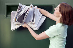 A mid-adult woman recycling paper Stock Images