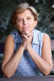 Mid adult woman smiles royalty free stock photo
