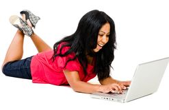 Mid adult woman using a laptop Royalty Free Stock Photography