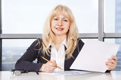 Mid adult woman  work with documents Royalty Free Stock Images