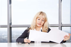 Mid adult woman  work with documents Royalty Free Stock Photo