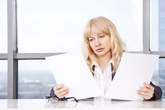 Mid adult woman  work with documents Stock Photo